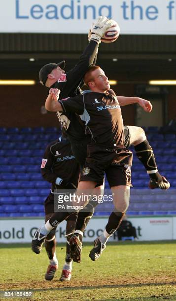 Bury's Adam Rooney and Stockport County's Conrad Logan during the CocaCola League Two match at Edgeley Park Stockport