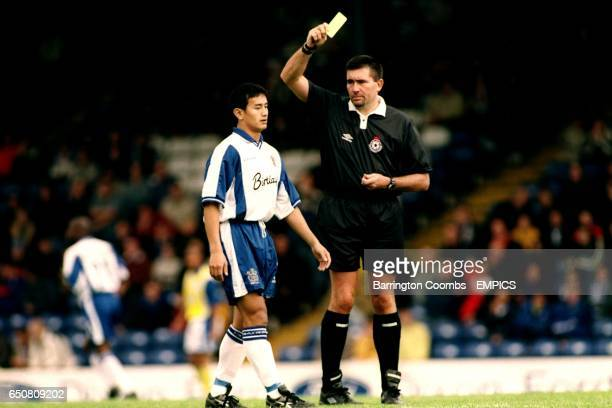 Bury's Asian player Baichung BHUTIA is booked during his debut match against Cardiff by referee Jeff WINTER
