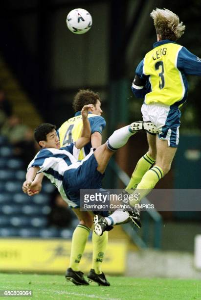 Bury's Baichung BHUTIA challenges Cardiff's Andy LEGG and Scott YOUNG