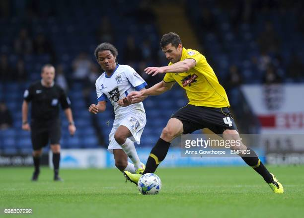 Bury's Duane Holmes and Burton Albion's John Mousinho in action