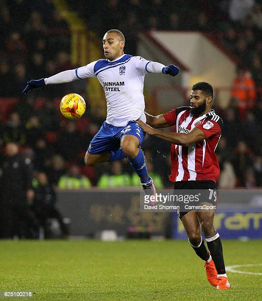 Bury's James Vaughan battles with Sheffield United's Ethan EbanksLandell during the Sky Bet League One match between Sheffield United and Bury at...