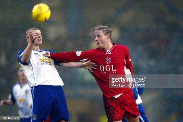 Bury's Michael Nelson battles with Kidderminster's Bo Henriksen