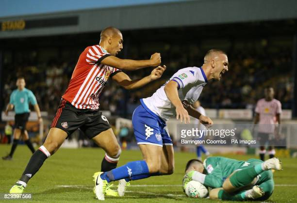 Bury's Tom Aldred and Sunderland's James Vaughan during the Carabao Cup First Round match at Gigg Lane Bury