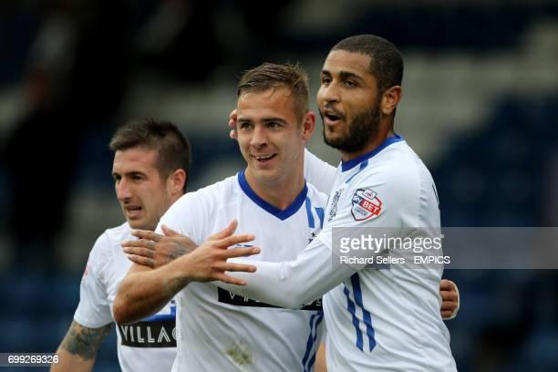 Bury's Tom Pope celebrates scoring Bury's 2nd goal with Bury's Leon Clarke