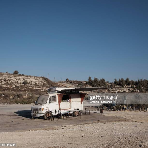 A bus bar where families await the release of prisoners from Ofer prison This is the story of Palestinian prisoners'u2019 wives who have turned to...