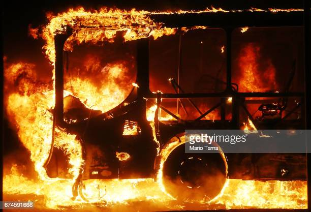 A bus burns after being set on fire by protestors during a nationwide general strike on April 28 2017 in Rio de Janeiro Brazil The general strike was...