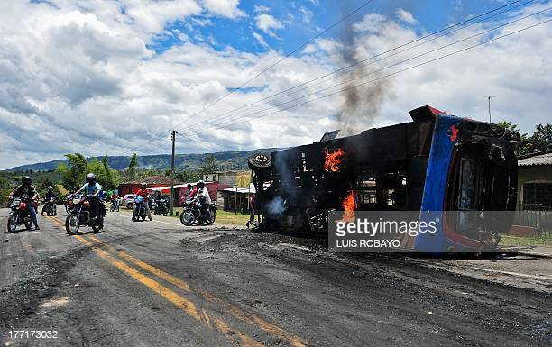 A bus burnt down by protesters lies on the Panamerican highway in the village of El Cairo rural area of Piendamo Cauca department Colombia on August...