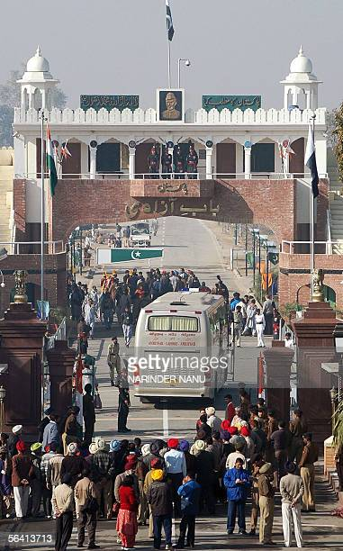 CORRECTION A bus carrying local officials crosses the IndiaPakistan border at Wagah in India's northern state of Punjab 11 December 2005 as part of a...