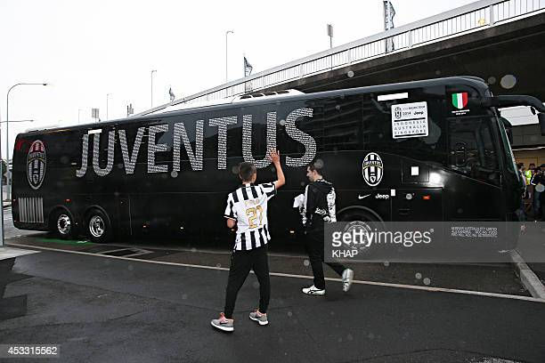 A bus carrying members of Italian soccer team Juventus is seen after arriving at Sydney International Airport ahead of their match against the...