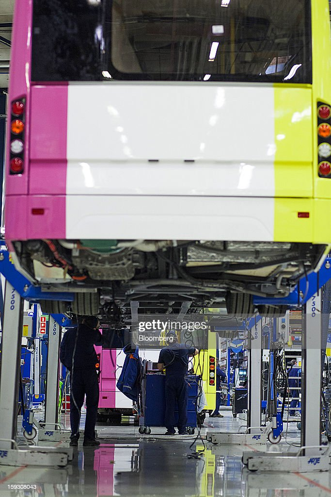 A bus chassis stands on Arje Sweden AB vehicle hoists to allow workers access to the vehicle's underside during assembly at Volvo AB's manufacturing plant in Wroclaw, Poland, on Friday, Jan. 11, 2013. Volvo plans to end bus making in Saeffle by June 2013, and will consolidate the business in Europe to its main plant in Wroclaw, Poland, the Gothenburg, Sweden-based company said. Photographer: Bartek Sadowski/Bloomberg via Getty Images
