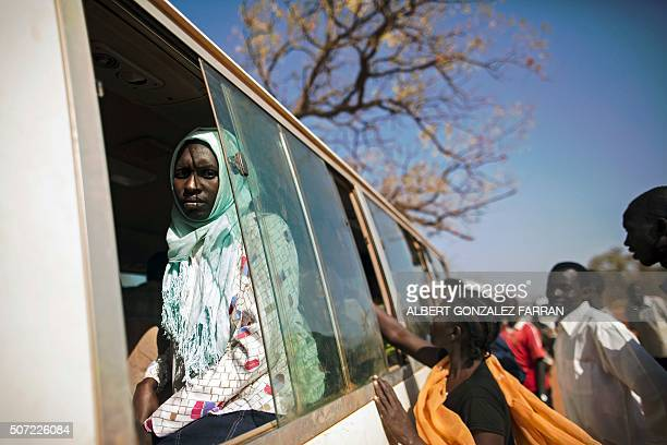 TOPSHOT A bus departs from Ajuong Thok refugee camp in South Sudan less than 100 kms away from the border with Sudan on January 28 2016 The bus will...