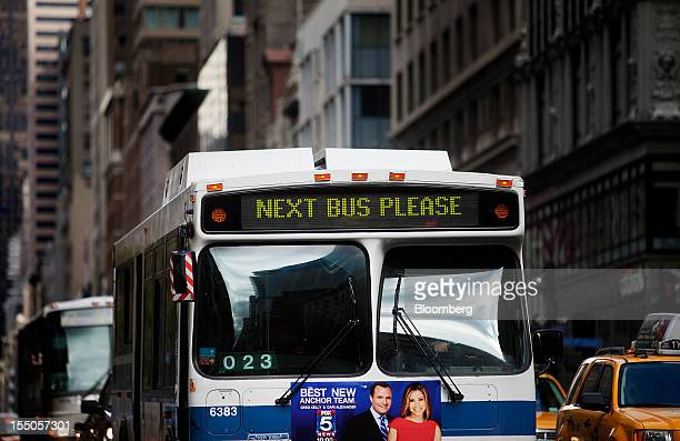 A bus displays a sign reading 'Next Bus Please' while the Metropolitan Transit Authority subway service is suspended due to flooding and power...