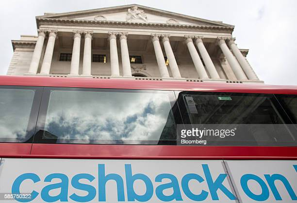 A bus displays an advert which reads 'Cashback On' as it passes in front of the Bank of England in the City of London UK on Thursday Aug 4 2016 The...