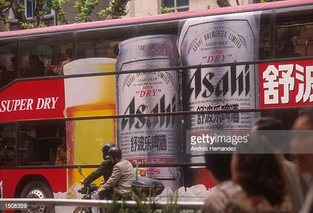 A bus displays an advertisement for Asahi Beer May 1998 in Shanghai China Foreign influence has played a major role in Shanghai's economic growth
