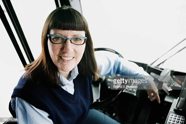 Bus driver at steering wheel