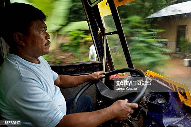 EL NIDO PALAWAN PHILIPPINES A bus driver concentrates as the road from El Nido to Palawan is dangerous with many accidents along the way