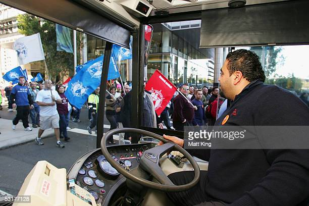 A bus driver is held up in traffic as New South Wales workers march towards the Sydney Harbour Bridge after attending Australia's largest ever...