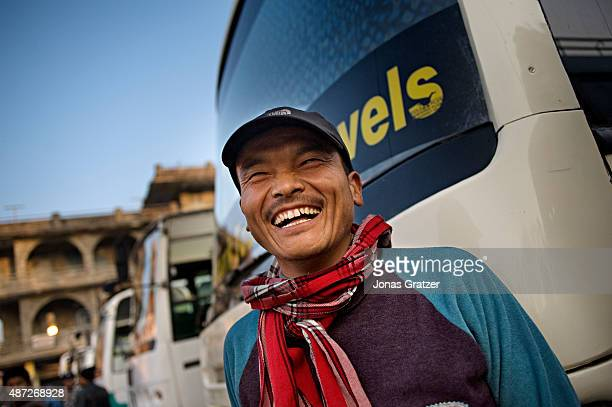 A bus driver laughs loudly when asked if he is ever afraid to drive on Nepal's narrow roads in the Himalayan mountain slopes