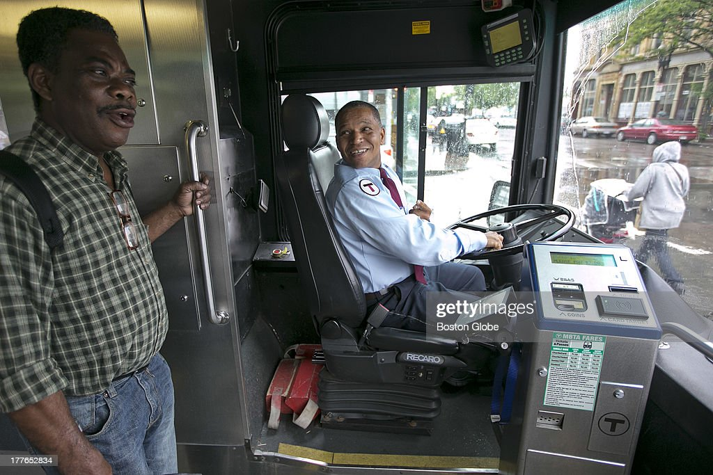 MBTA bus driver Miguel Goncalves spoke with friend Nathan Ewusi of Dedham Ewusi who rides bus 15 worked at Walgreens where Goncalves would take...