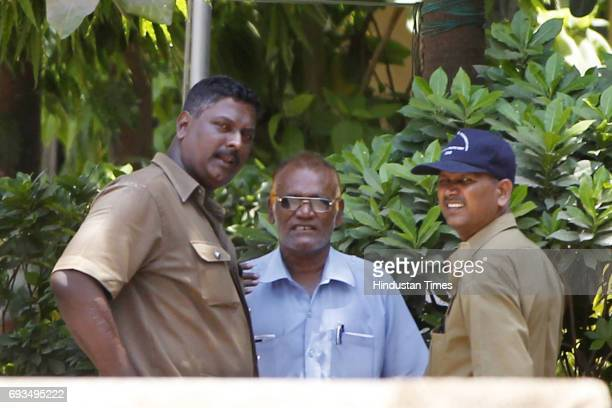 Bus driver Pravin Kubal an unidentified ticket checker and conductor Deepak Kanal outside the Versova police station on Tuesday