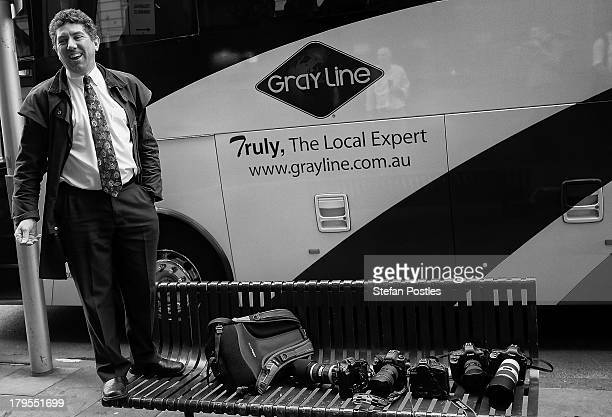 A bus driver stands on a bench talking to members of the media on September 4 2013 in Melbourne Australia Australian voters will head to the polls on...