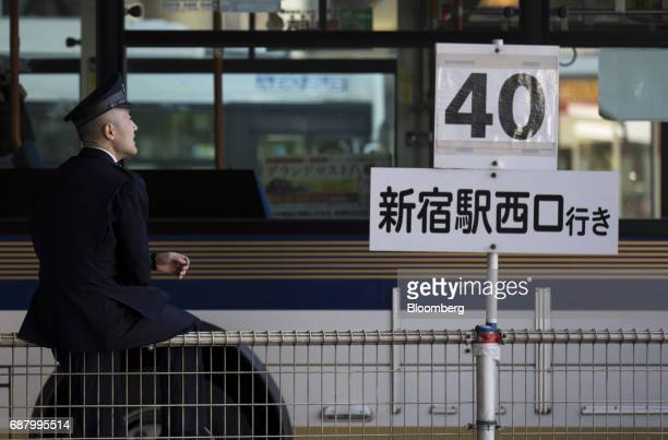 A bus driver takes a rest in the Shibuya area of Tokyo Japan on Tuesday May 23 2017 Japan's consumer price index for April will be released on May 26...