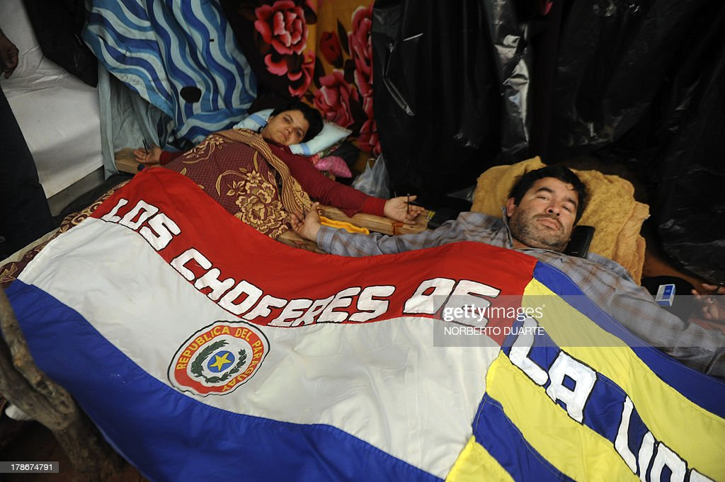 Bus drivers continue their protest initiated more than 30 days ago during which they remained crucified on their cots in protest for having been fired from their jobs, in Asuncion, on August 30, 2013. PHOTO