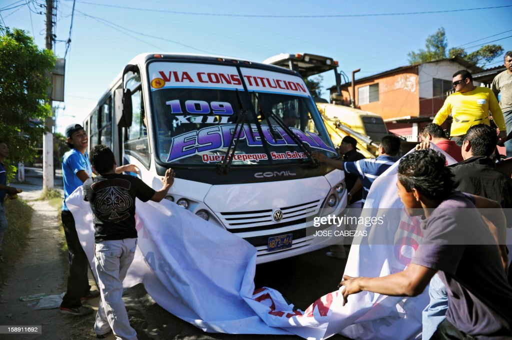 Bus drivers prevent a bus from moving during a strike in San Salvador, on January 3, 2013. Bus owners and drivers called for a strike in demand of a rise in the price of the ticket for the buses of public transportation. AFP PHOTO/ Jose CABEZAS