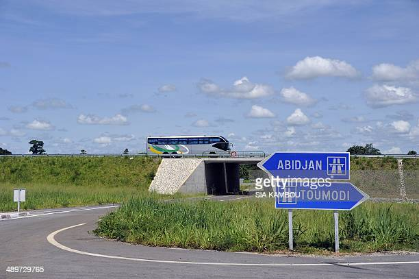 A bus drives along the new 230 km long AbidjanYamoussoukro highway on May 11 2014 This northern highway inaugurated on December 11 2013 by Ivory...