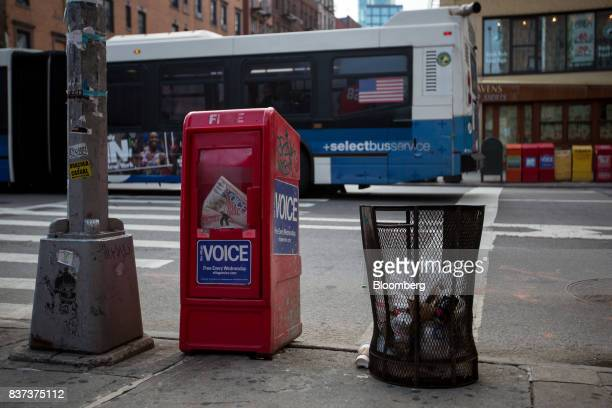 A bus drives past a distribution box for The Village Voice in the East Village neighborhood of New York US on Tuesday Aug 22 2017 Peter Barbey owner...