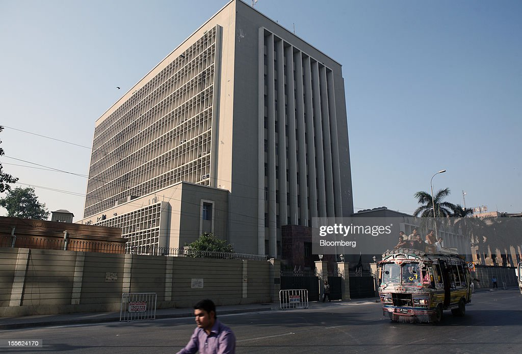 A bus drives past the State Bank of Pakistan building in Karachi, Pakistan, on Wednesday, Oct. 31, 2012. Businesses in Pakistan's commercial capital are bracing for a surge in extortion demands as parties representing the city's ethnic communities seek to use their hired guns to build financial war chests ahead of parliamentary polls due in the first half of next year. Photographer: Asim Hafeez/Bloomberg via Getty Images