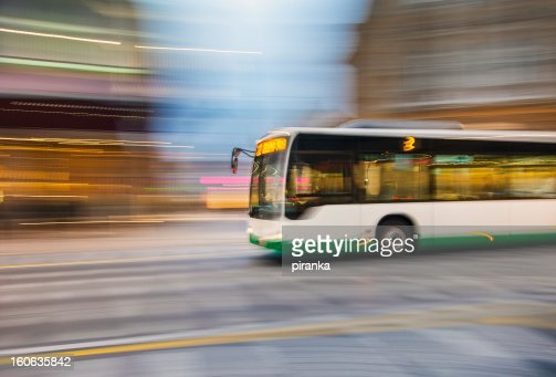 Bus driving on city street