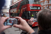Bus enthusiasts photograph London's newest red doubledecker Routemaster bus which is seen in service on the capital's streets for the first time The...