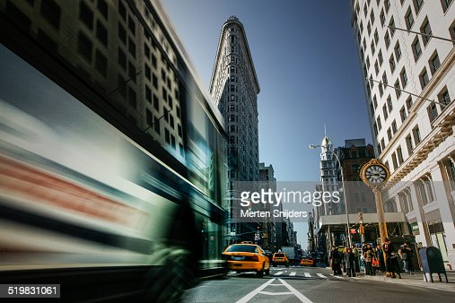 Bus in motion on Fifth avenue