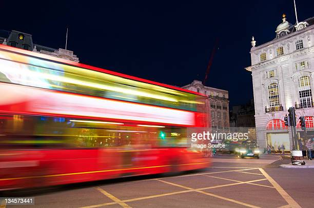Bus in motion on Piccadilly Circus, London, UK