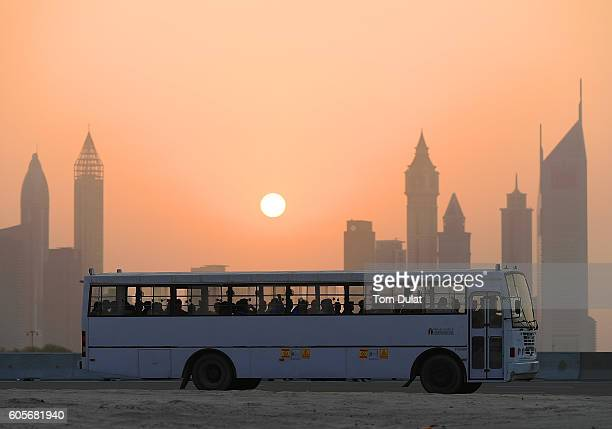 A bus is pictured carrying workers back from a construction site on September 14 2016 in Dubai United Arab Emirates