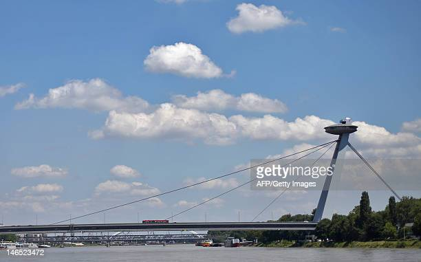 A bus is seen on the Novy Most asymetrical suspension bridge above the Danube in Bratislava on June 15 2012 AFP PHOTO / ALEXANDER KLEIN