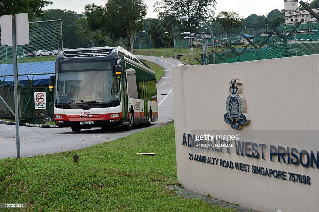 A SMRT bus leaves the Admiralty West prison after taking mainland Chinese bus drivers to the prison in Singapore on December 1, 2012. About 25 SMRT bus drivers from China was taken to the prison on December 1, reported a local website after a recent strike in Singapore where four were charged in court.