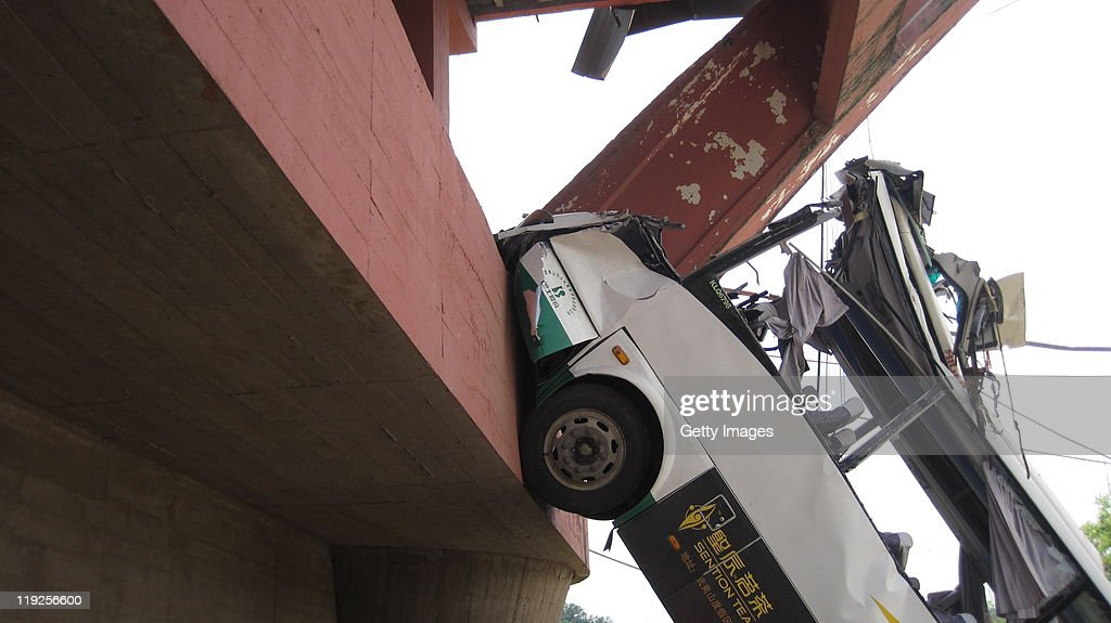 A bus lies crumpled on the ground after The Wuyishan Gongguan Bridge collapsed on July 14, 2011 in Wuyishan, Fujian province of China. One person was killed and 22 injured after a bus plunged from the collapsed Wuyishan Gongguan Bridge. The cause of the Bridge collapse is not as yet known.