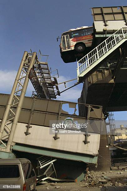 A bus manages to stay on the evelated Hanshin Expressway a after the Great Hanshin earthquake on January 17 1995 in Nishinomiya Hyogo Japan Magnitude...