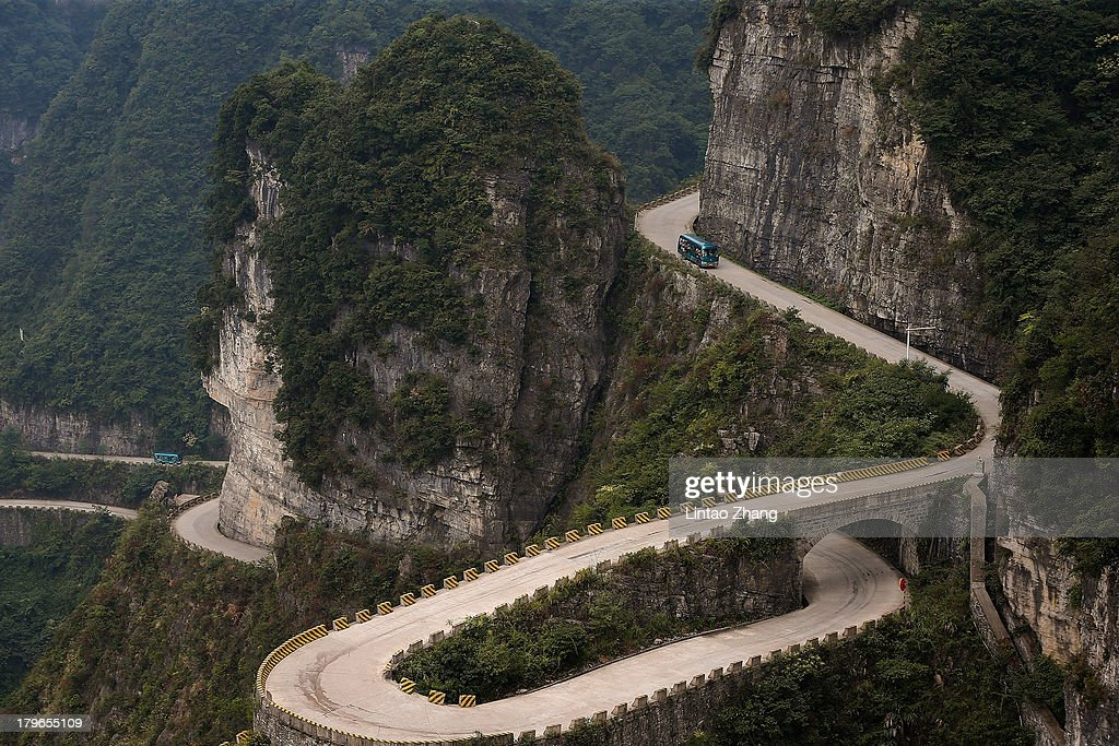 A bus moves on the mountain roads on September 1, 2013 in Zhangjiajie, China. Zhangjiajie National Forest park is a popular tourist destination in the Hunan province, home to striking sandstone and quartz cliffs and famously known for renaming a peak after the mountain formations inspired the fictional world of 'Pandora' in James Cameron's film, 'Avatar'.