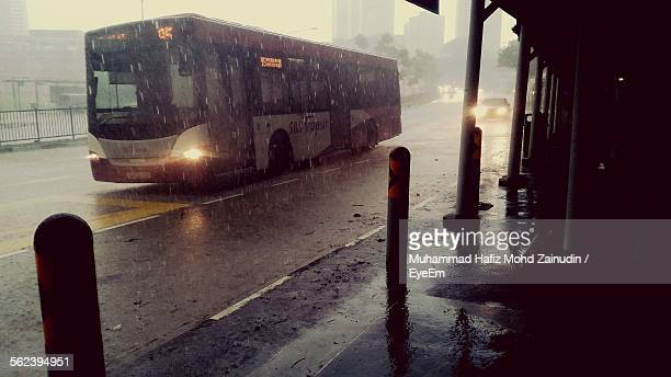 Bus Moving On Road During Rainy Season