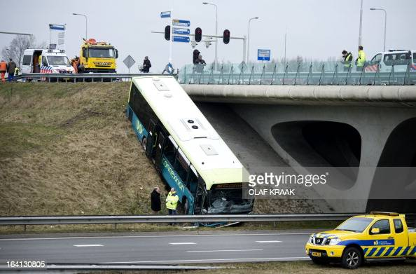 A bus of the public transport operator Connexxion sits on the embankment after an accident with a car on the provincial road N242 in Alkmaar The...