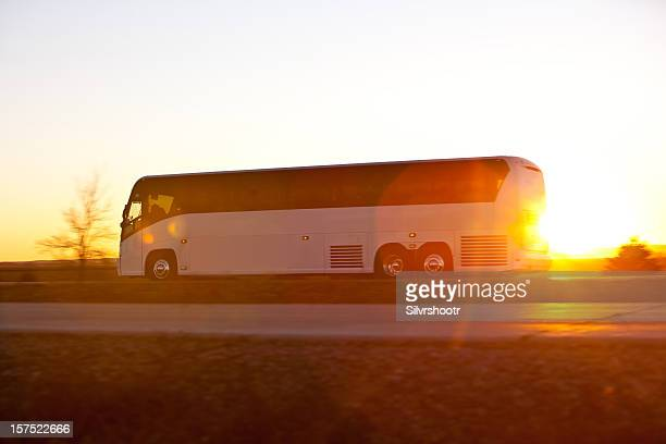Bus on the highway at sunrise