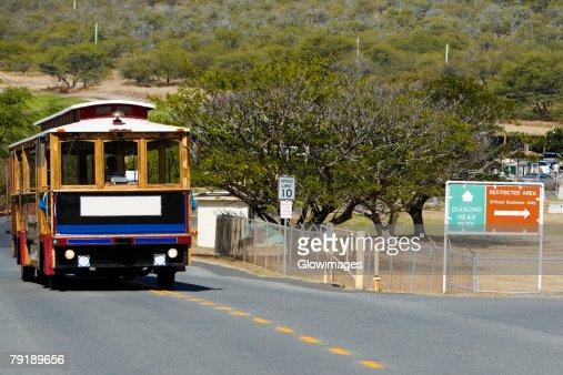 Bus on the road, Diamond Head, Waikiki Beach, Honolulu, Oahu, Hawaii Islands, USA : Stock Photo