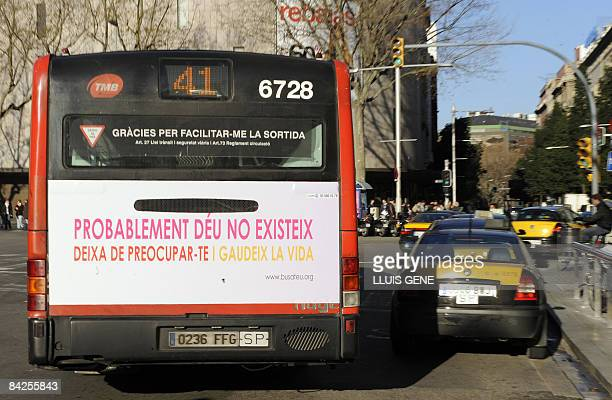 A bus on which an advertisement reads 'There's probably no God Now stop worrying and enjoy your life' is pictured on January 12 the first day that...