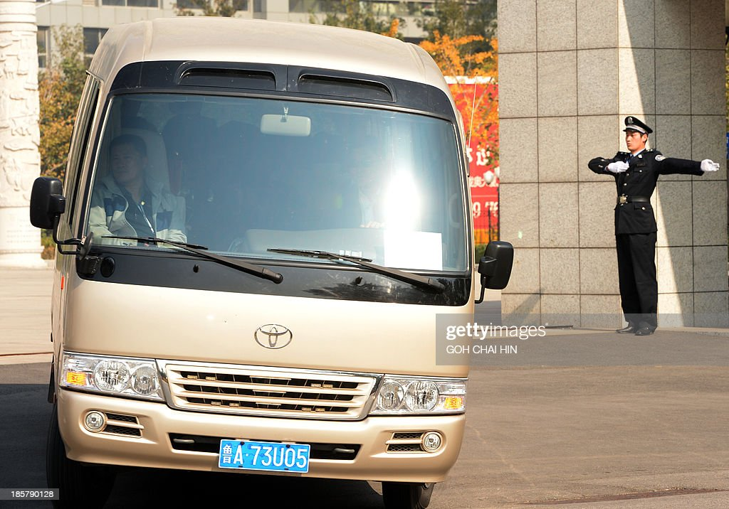 A bus, part of the convoy carrying Bo Xilai leaves the Shandong high court building in Jinan, east China Shandong province on October 25, 2013. A Chinese court rejected fallen politician Bo Xilai's appeal against his corruption conviction and confirmed his life sentence on October 25, as authorities looked to draw a line under a damaging scandal.