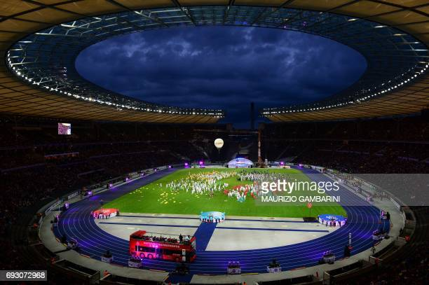 A bus passes by during the Stadium Gala of the 2017 Deutsches Turnfest at the Olympic Stadium in Berlin on June 6 2017 / AFP PHOTO / dpa / Maurizio...