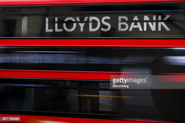 A bus passes sign above a Lloyds bank branch a unit of Lloyds banking Group Plc in London UK on Friday Aug 4 2017 Lloyds is in talks to lease a new...