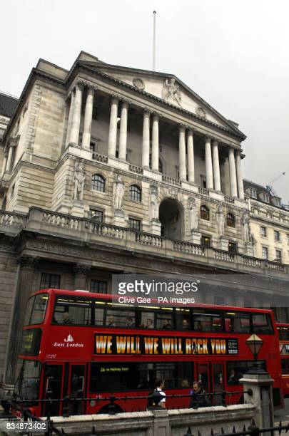 A bus passes the Bank of England in London which today cut interest rates by 15% in its most dramatic attempt yet to rescue an economy on the brink...